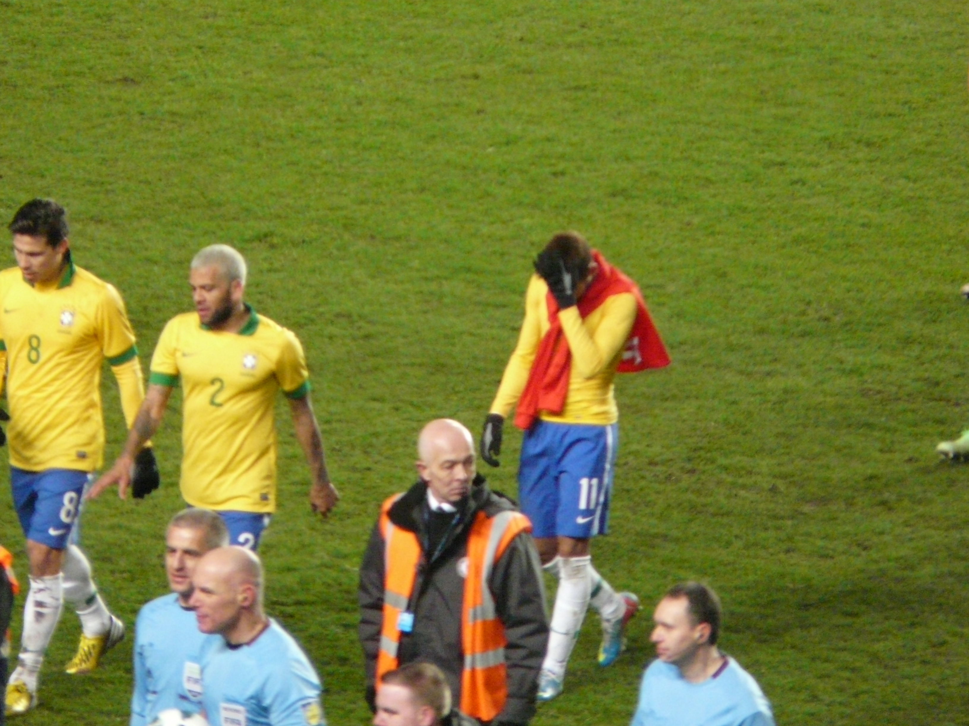 Head in hands, Neymar walks off the pitch
